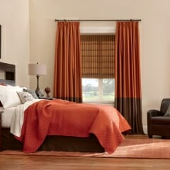 Two Tone Drapes Over A Woven Wood Shade