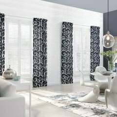 Patterned Curtains Over Plantation Shutters For The Dining Area