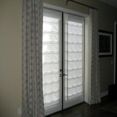 Flowing Pleat Drapery Side Panels On French Doors With Roman Shades