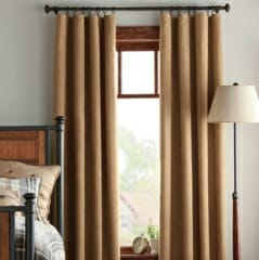 ripplefold-linen-draperies-with-clipped-metal-rings-on-metal-drapery-rod