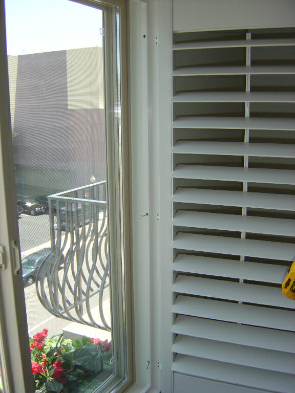 Faux wood shutters video photo gallery for Vinyl vs wood exterior shutters