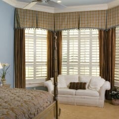 Polycore Faux Wood Shutters In The Bedroom