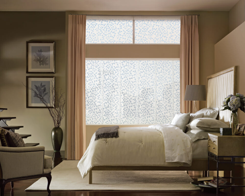 Roller Shades With Drapery Side Panels In A Bedroom