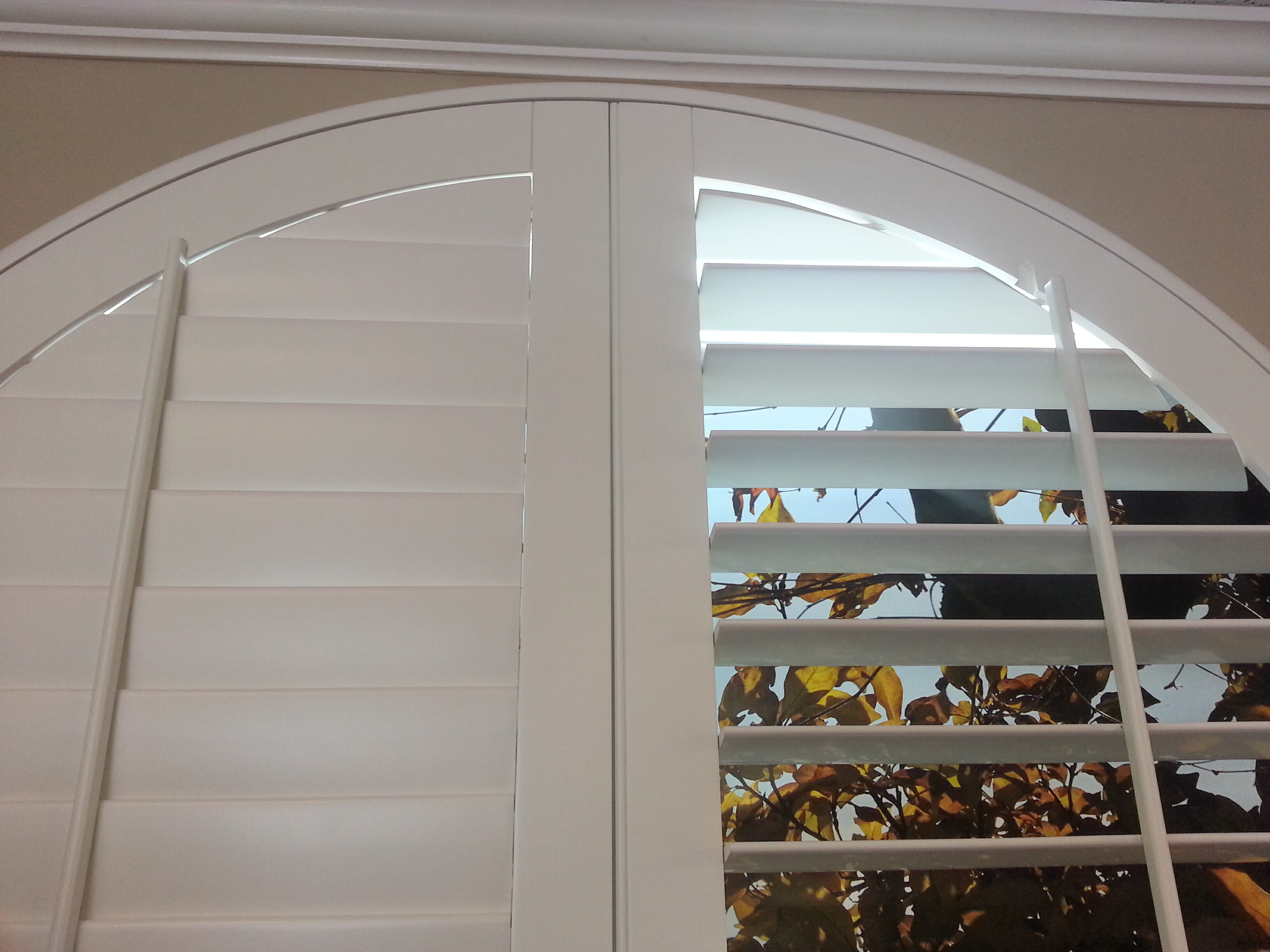 Window treatment for arch window - Fully Framed Arched Wood Shutter With Standard Tilt Bars