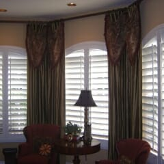 Full Louvered Arch Shutters With Draperies