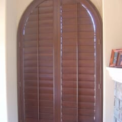 Fully Framed Arched Plantation Shutter In The Closed Position