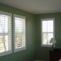 White Wood Shutters In Bedroom