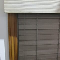 Textured Wood Cornice Over Wood Blind