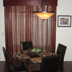 woven-wood-drapery-over-a-sliding-glass-door-with-a-triple-hobbled-valance