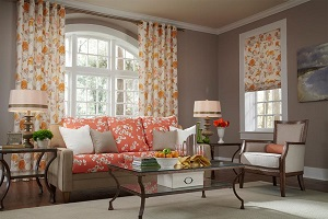 Custom curtains and draperies in a floral designed living room on a vertically long window.