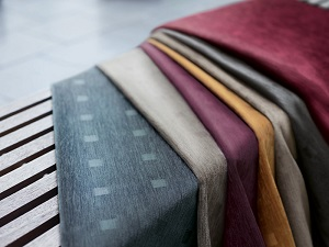 Materials and fabrics laying over each other to display their similarities and differences.
