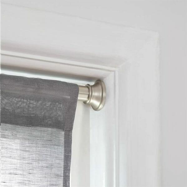 curtain rod inside the window frame