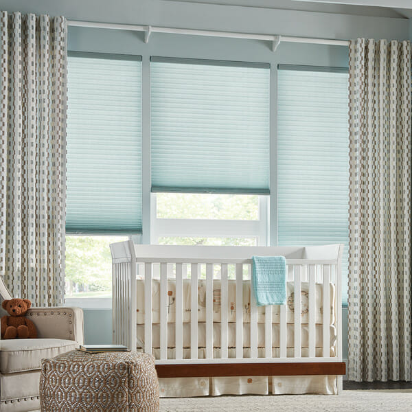 Drapes in front of cellular shades