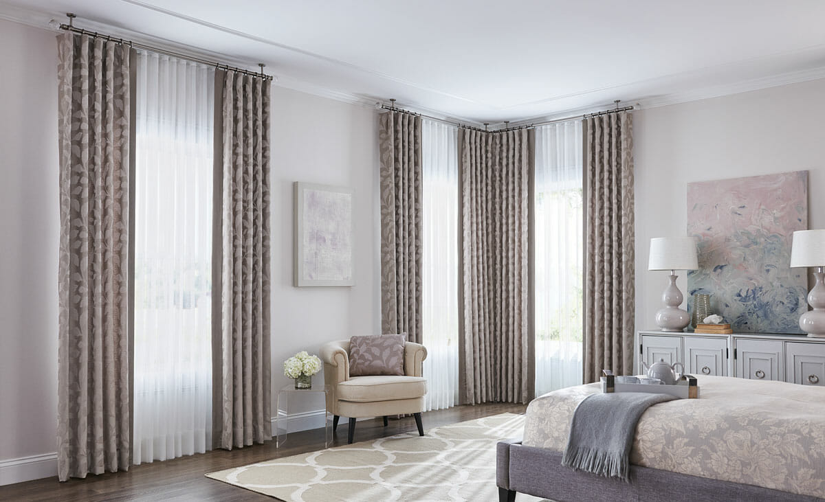Doubling up two layers of curtains is one way to get more complete light control