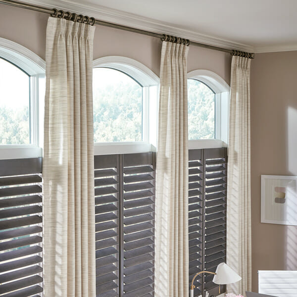 Plantation shutters with drapes