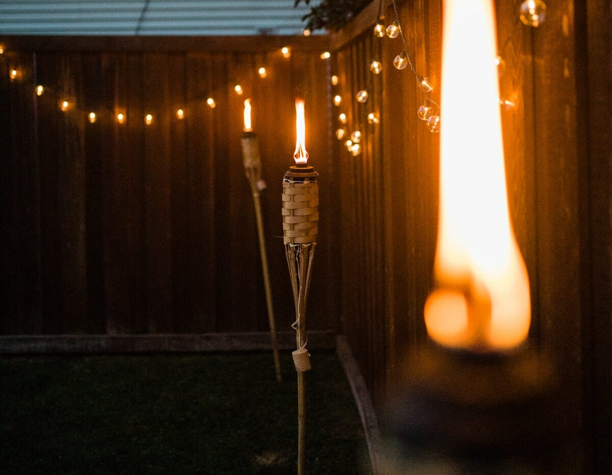 Add string lights and torches for an awesome backyard experience