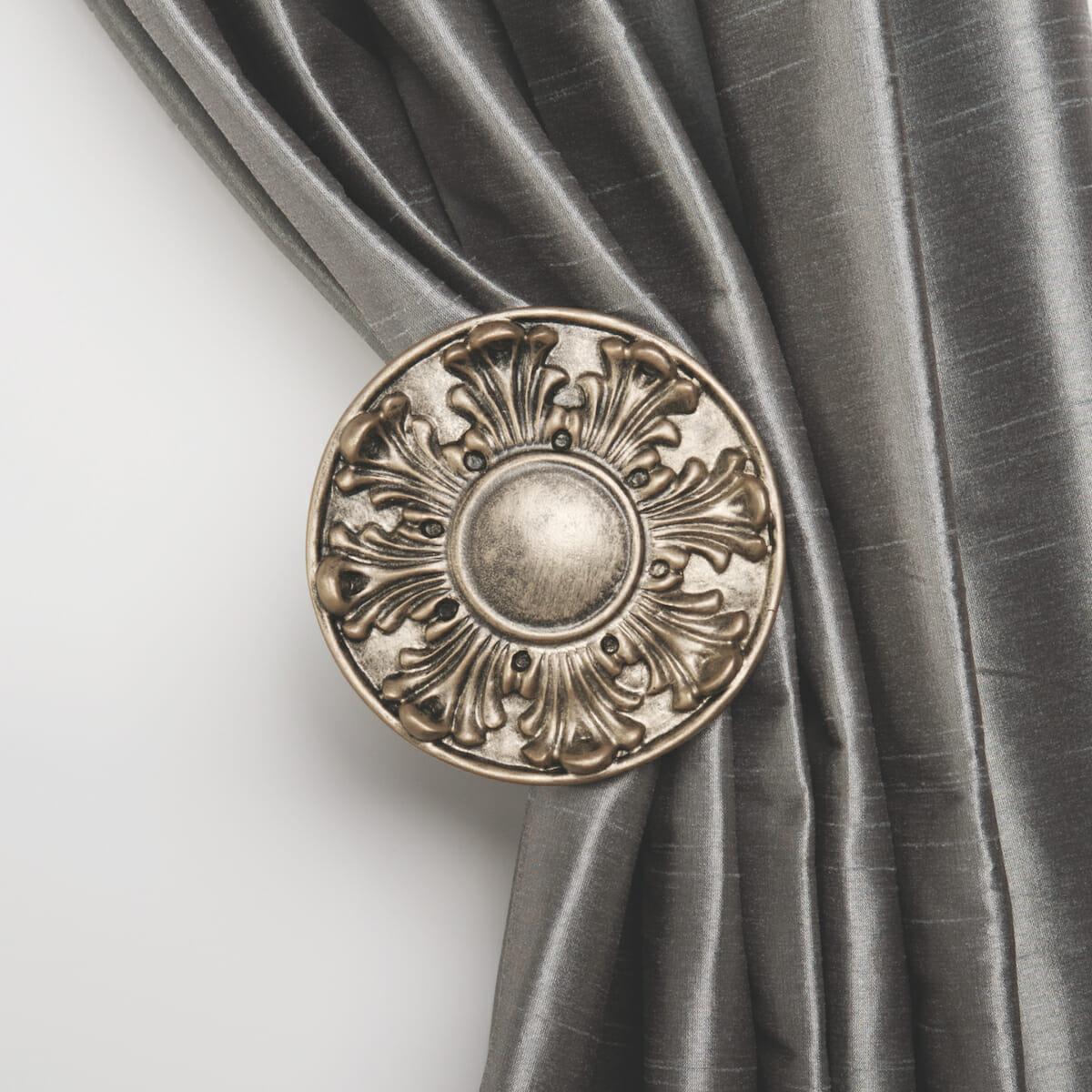 Curtain holdbacks with an elegant flourish put the finishing touch.