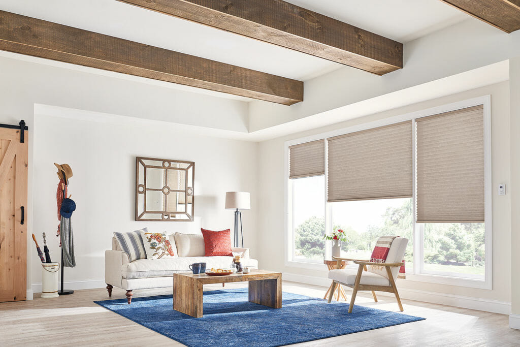Honeycomb Shades complement high ceilings with beautifully exposed beams